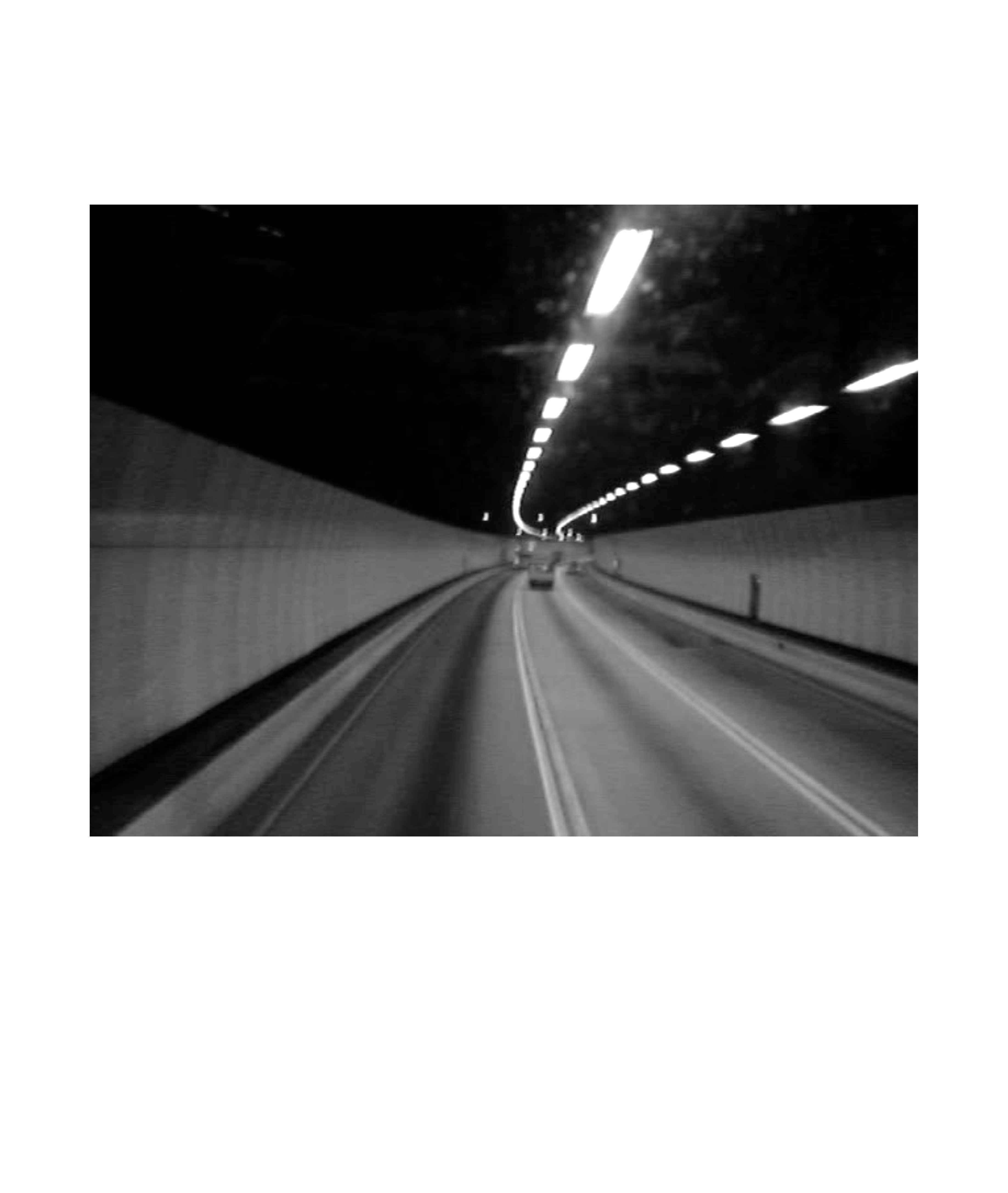 photograph of car driving in tunnel