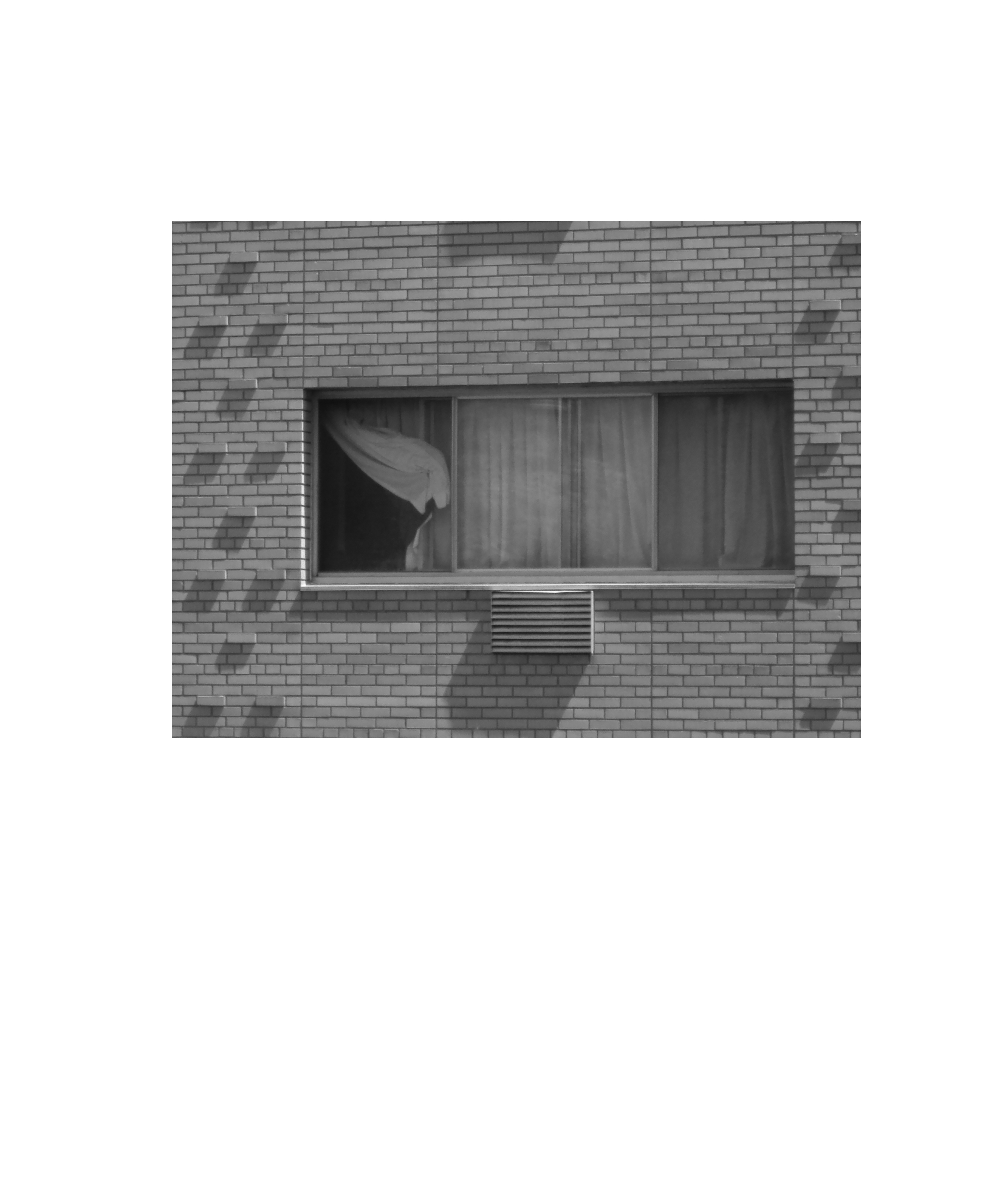 photograph of brick wall with window